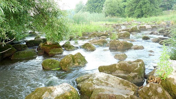 Cover Image for Fast Flowing River With Stones In The Water
