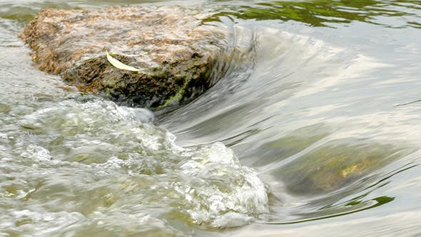 Thumbnail for Fast Flowing River With Stones In The Water Ultra