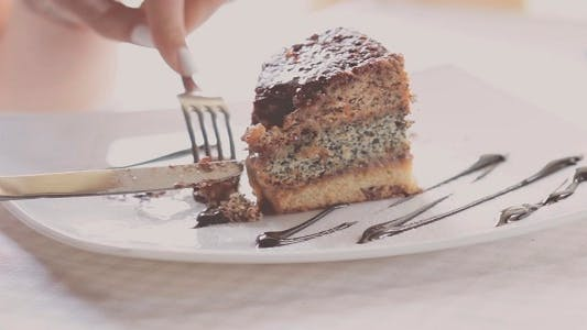 Thumbnail for Woman Eating Cake In Restaurant