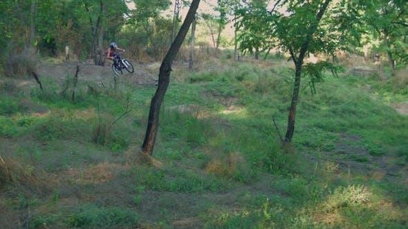 Thumbnail for Long Jump On Springboard Of Biker