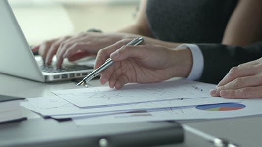 Thumbnail for Working Hands And Financial Documents Background