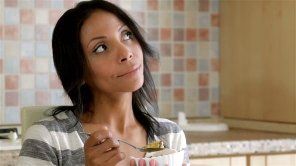 Thumbnail for Beautiful Lady Eating Cereals At Home