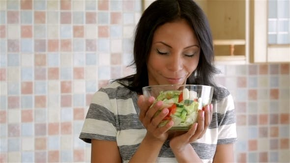 Thumbnail for Housewife In Kitchen With Salad
