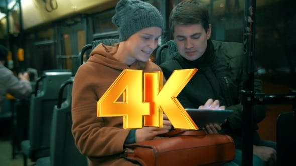 Thumbnail for Young People Using Tablet Computer In The Bus