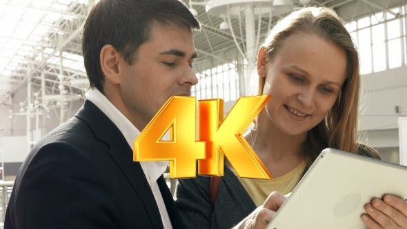 Thumbnail for Young Happy Man And Woman Talking On Business With