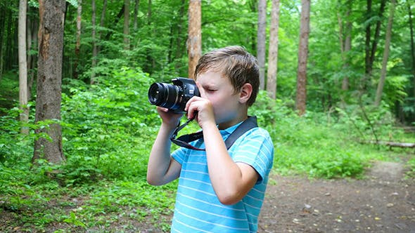 Thumbnail for Boy In Wilderness Area Taking Picture