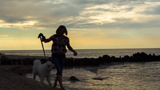 Thumbnail for Running With a Dog Along the Seashore