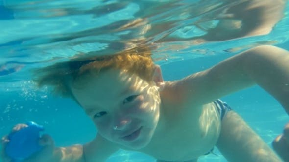 Thumbnail for Boy Swimming Underwater In Swimming Pool