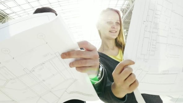 Thumbnail for Young Engineers Discussing Building Construction