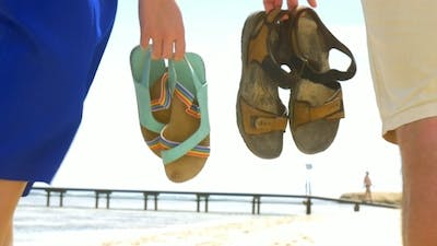 Summer Shoes In People's Hands