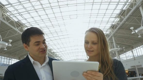Thumbnail for Business People With Tablet PC In Office Building