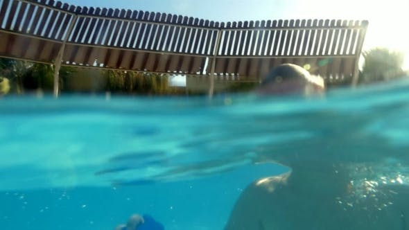 Thumbnail for Child Enjoying Swimming In Outdoor Pool