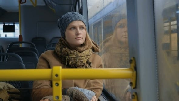 Thumbnail for Woman Passenger Looking Out Bus Window