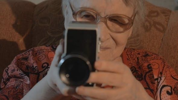 Thumbnail for Senior Woman Filming With Retro Video Camera