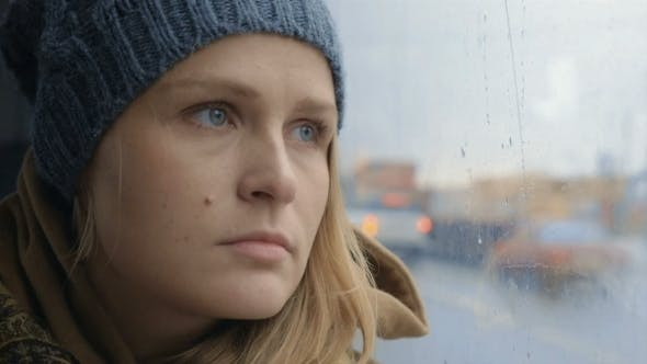 Thumbnail for Frustrated And Sad Woman Traveling By Bus On Rainy