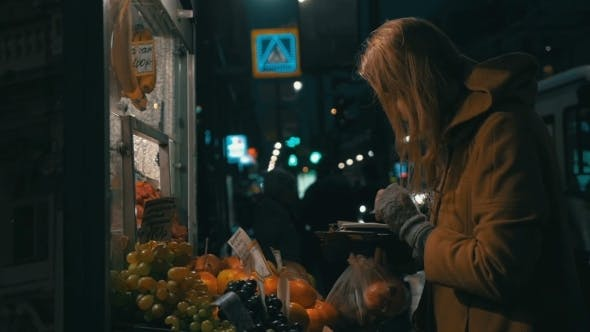 Thumbnail for Woman Buying Fruit In Street Stall