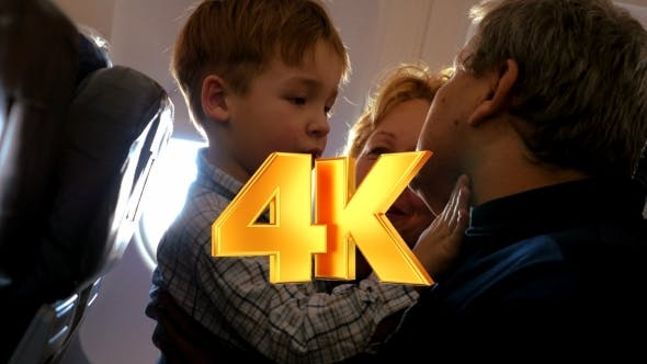 Thumbnail for Child Exploring Grandfathers Face In The Plane