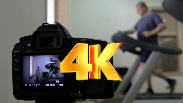 Thumbnail for Camera Making Shots Of Man Running On Treadmill
