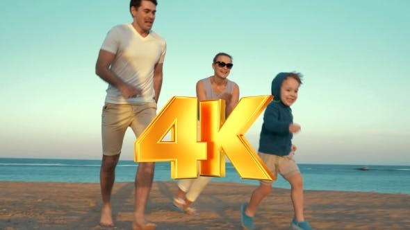 Thumbnail for Happy Family Of Three Playing On The Beach