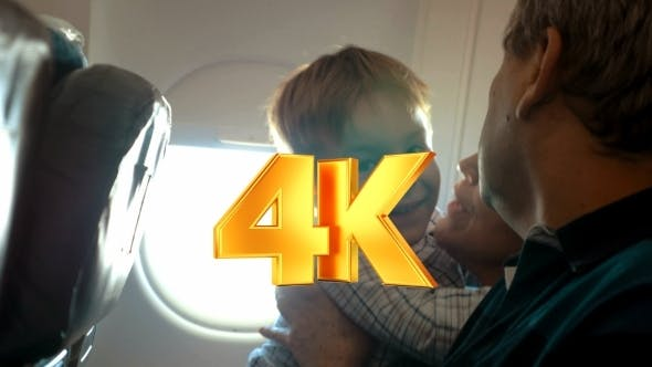 Thumbnail for Boy And His Grandmother Hugging In The Plane