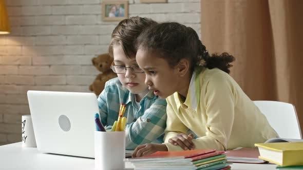 Little Children Typing on Laptop