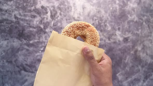 Fresh Bagel Bread in a Paper on Table