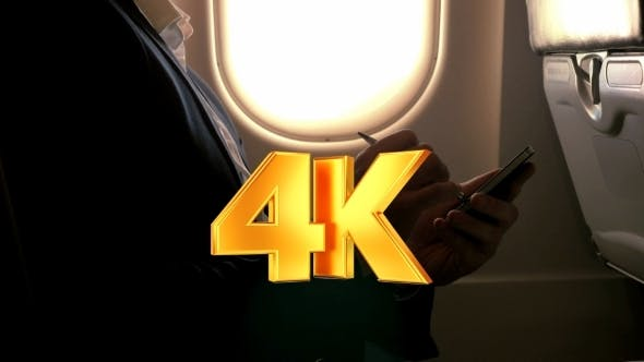 Thumbnail for Man Using Pen To Type On Smart Phone In Plane