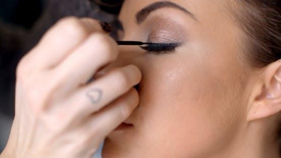 Thumbnail for Pretty Woman Applying Eye Liner On Her Eyelid