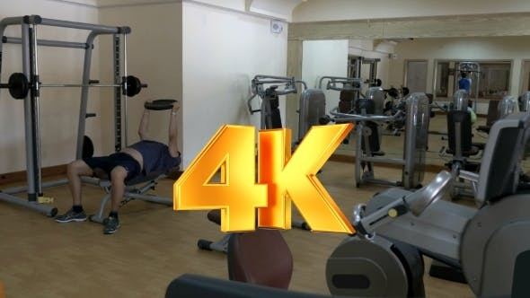 Thumbnail for Two People Working Out In Fitness Center