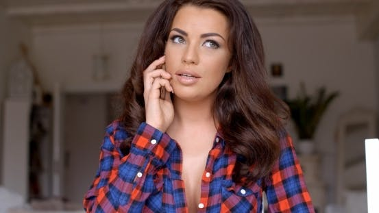 Thumbnail for Serious Attractive Young Woman Talking On Phone