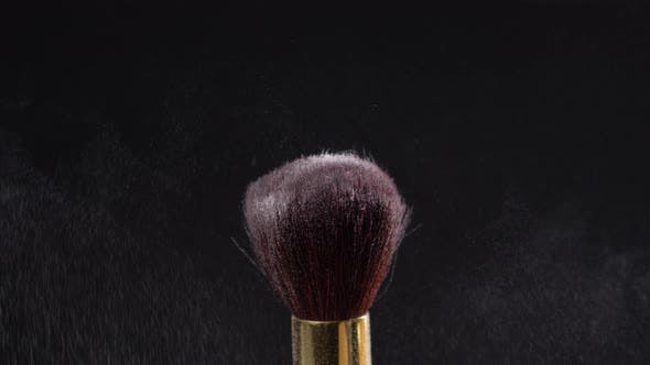 Thumbnail for Two Makeup Brushes with Powder on a Dark Background