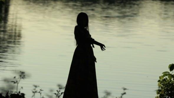 Thumbnail for Silhouette of a Slender Girl