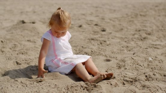 Thumbnail for Young Beautiful Girl Playing In Sand