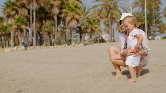 Thumbnail for Mom And Daughter At The Beach On a Very Sunny Day