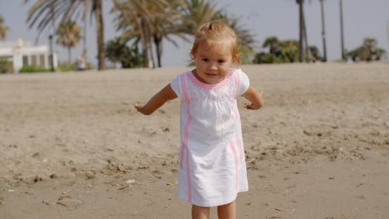 Thumbnail for Cute Little Girl Playing On The Beach