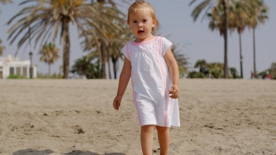 Thumbnail for Cute Little Girl Walking On The Beach