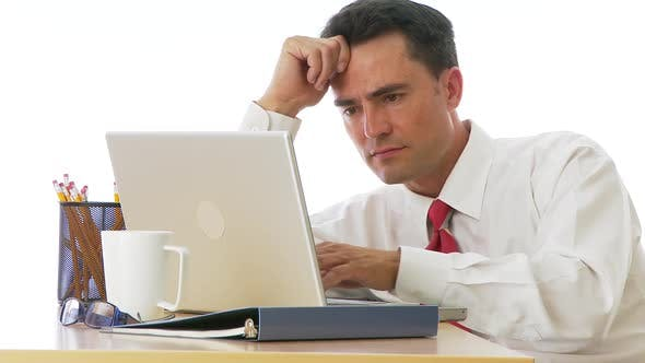 Thumbnail for Businessman typing at desk and laughing