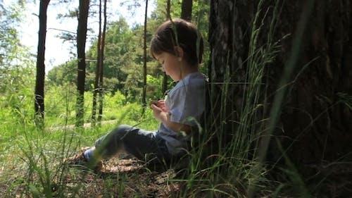 Baby Sitting Near a Tree