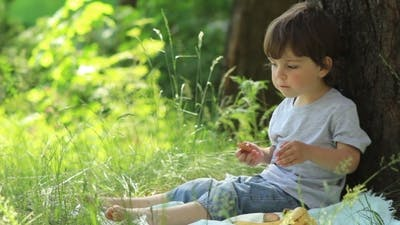 Child Resting In Nature