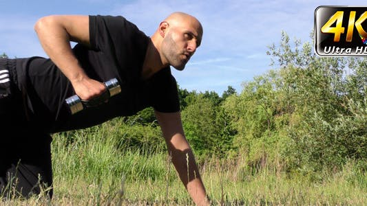 Thumbnail for Man Training in Nature On Grass