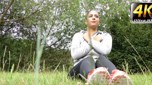 Thumbnail for Young Woman Training on Grass in Nature