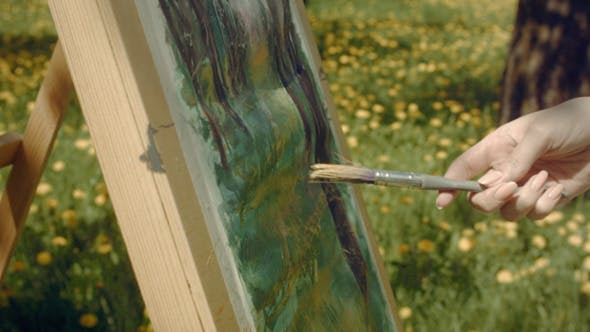 Thumbnail for Woman Artist Paints In The Garden