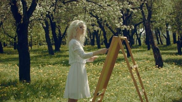 Thumbnail for Artist Paints In The Garden
