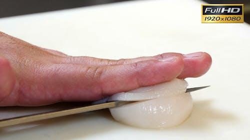 Sushi Chef Cutting a Scallop Sashimi Style