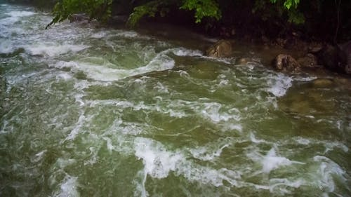 Mountain River Flowing Downhill