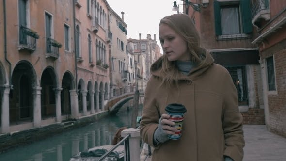 Thumbnail for Woman With Coffee Walking In Venice