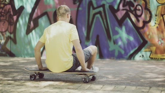 Thumbnail for Man Sitting On Longboard And Looking Into Distance