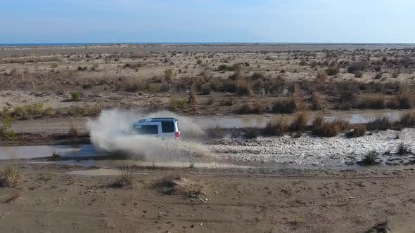 Thumbnail for Car is Passing Through the Water Aerial Following
