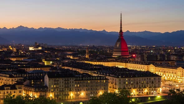 Timelapse day to night over Turin Italy, town wake up, colorful dramatic sky