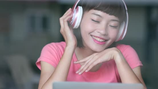 Thumbnail for Cheerful woman listen to music at home
